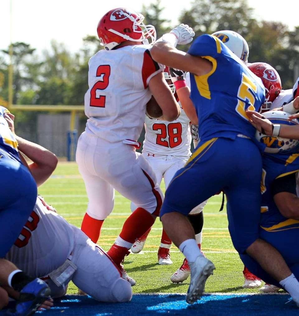 East Islip quarterback Jack Hannigan sneaks in for