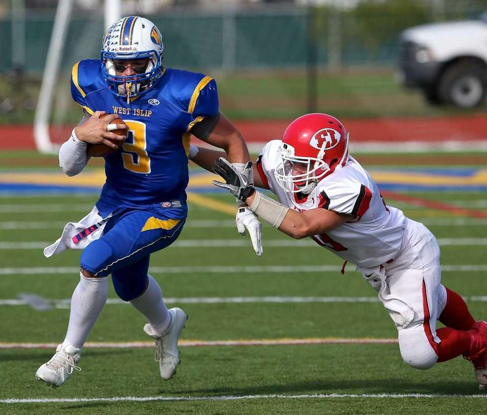West Islip quarterback Sam Ilario heads to the