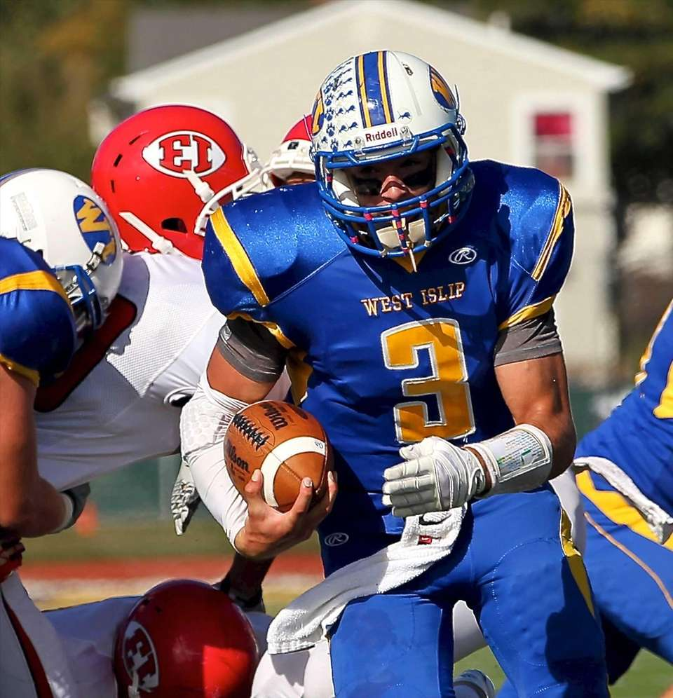 West Islip quarterback Sam Ilario runs the ball