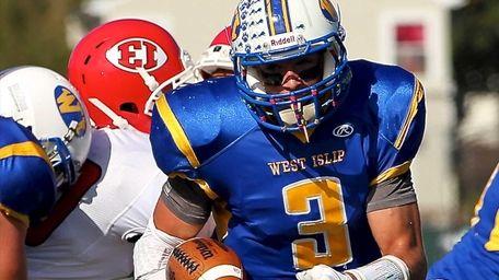 West Islip quarterback Sam Ilario runs the ball