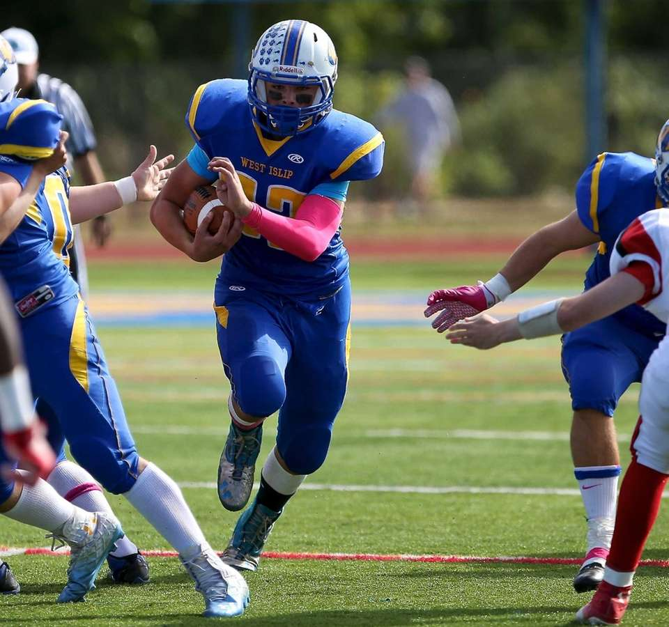 West Islip running back Matt McKeon bursts through