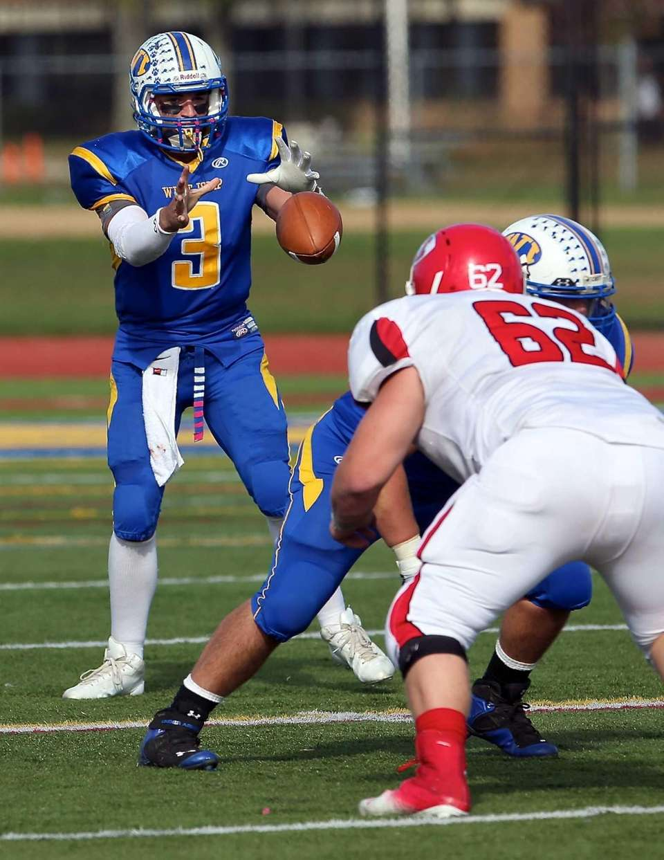 West Islip quarterback Sam Ilario takes the snap