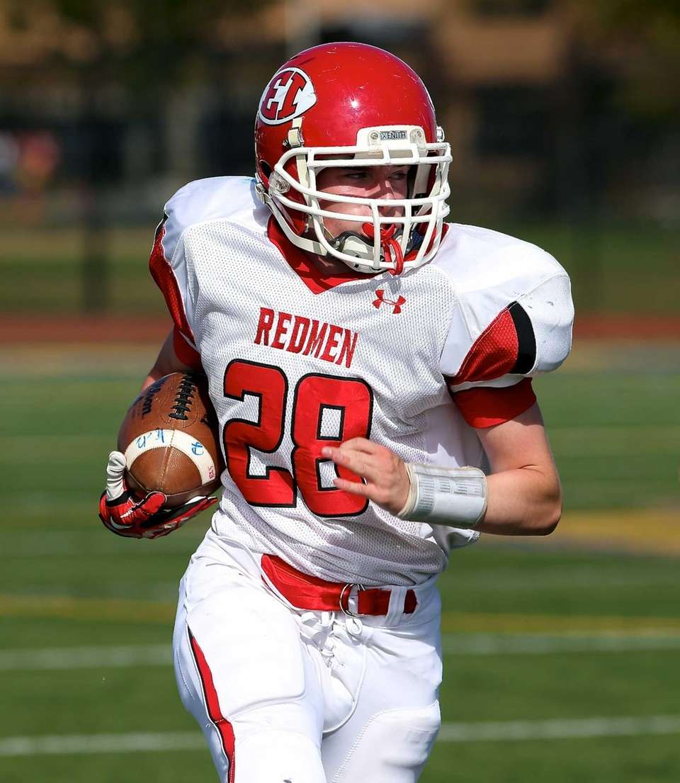 East Islip running back Sean Karika heads down