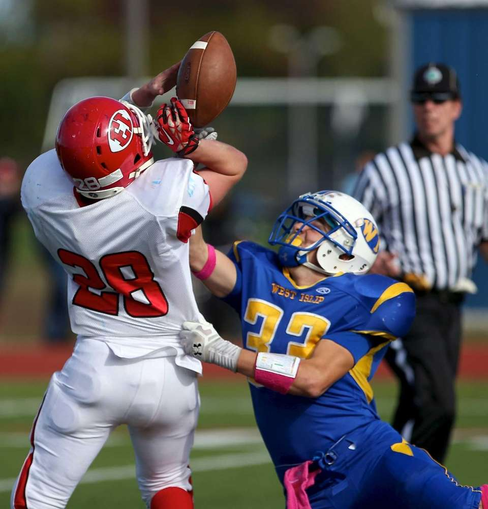 West Islip defensive back A.J. Illchert breaks up