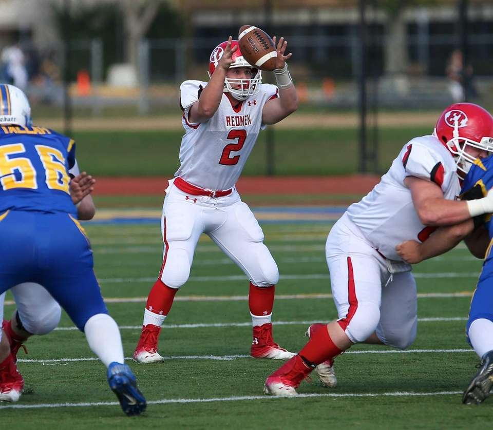 East Islip quarterback Jack Hannigan grabs the high