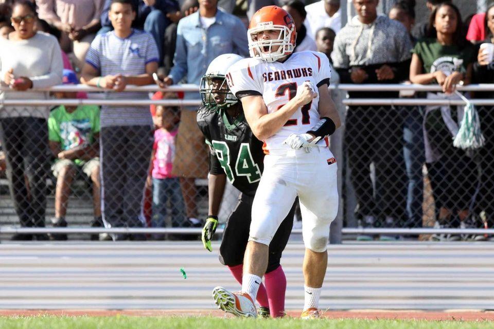 Carey's Matt Robison celebrates a touchdown against Elmont.