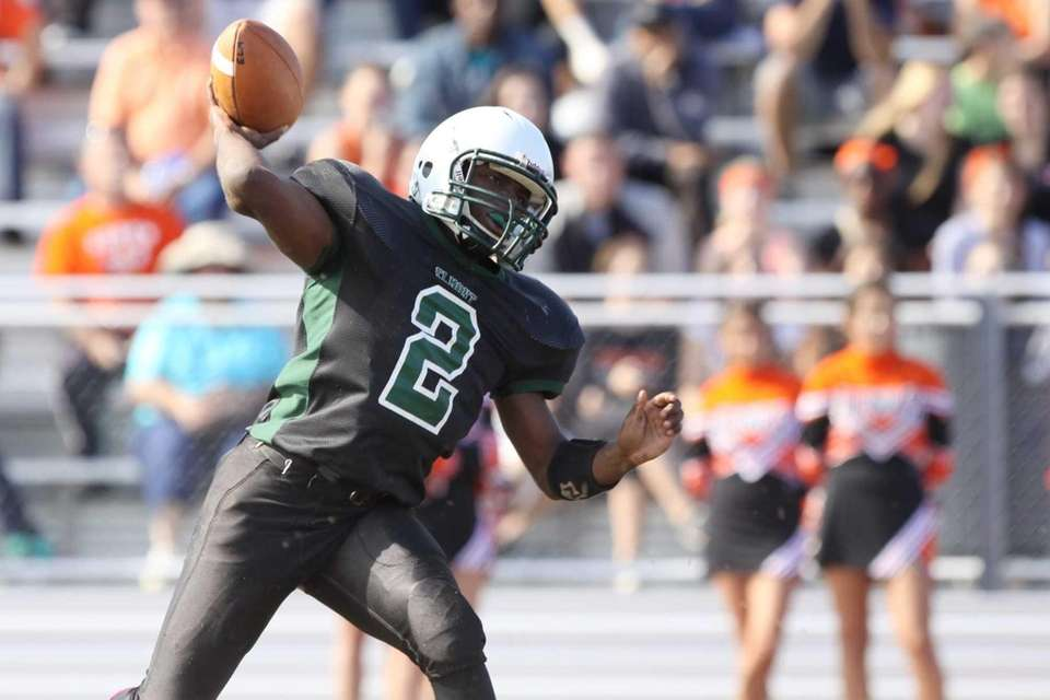 Elmont quarterback Sydney Flowers looks to pass against