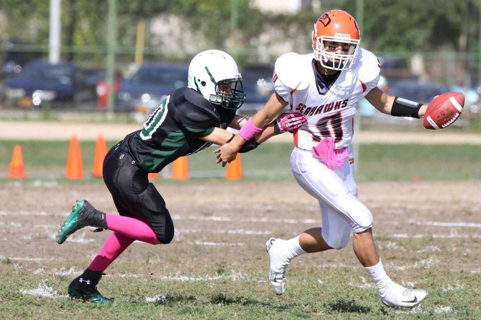 Carey's Ray Catapano (right) tries to elude the