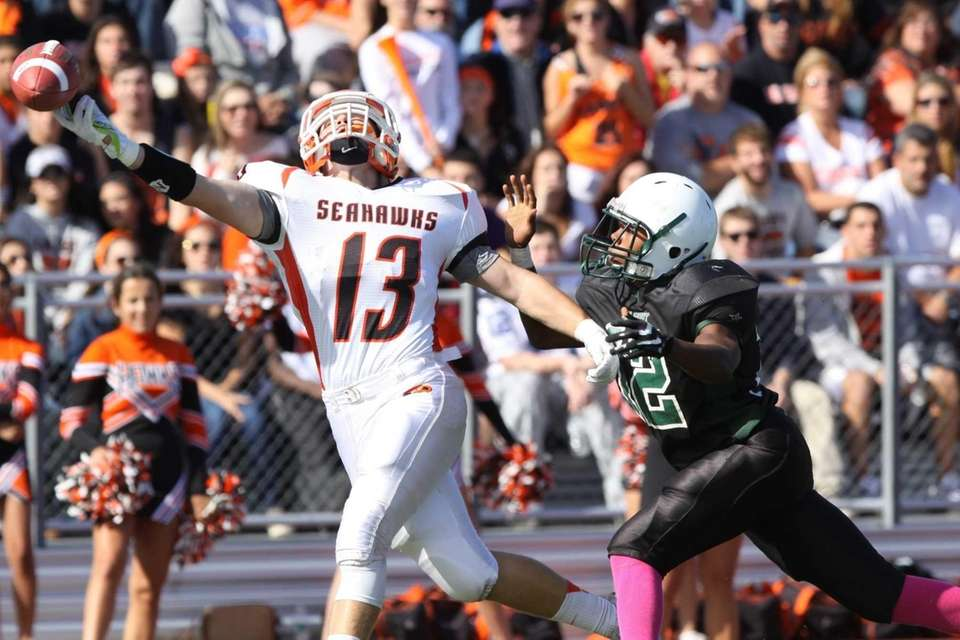 A pass intended for Carey's Nick Spillane (left)