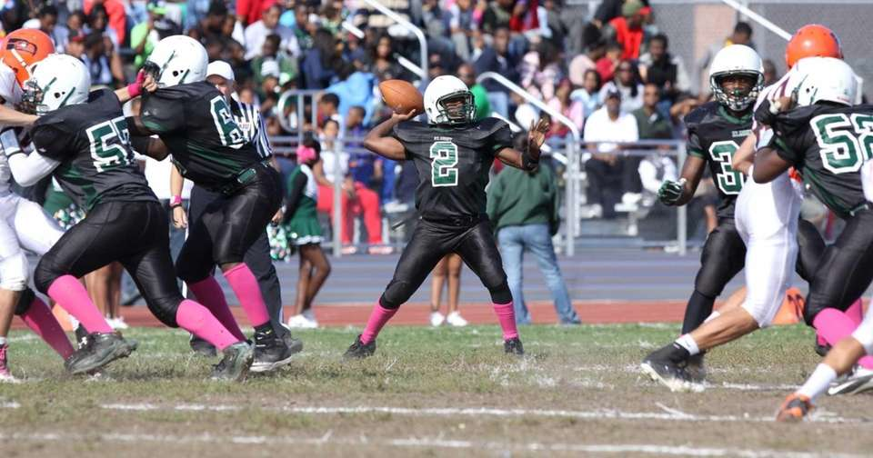 Elmont's Sydney Flowers (no. 2) throws the ball