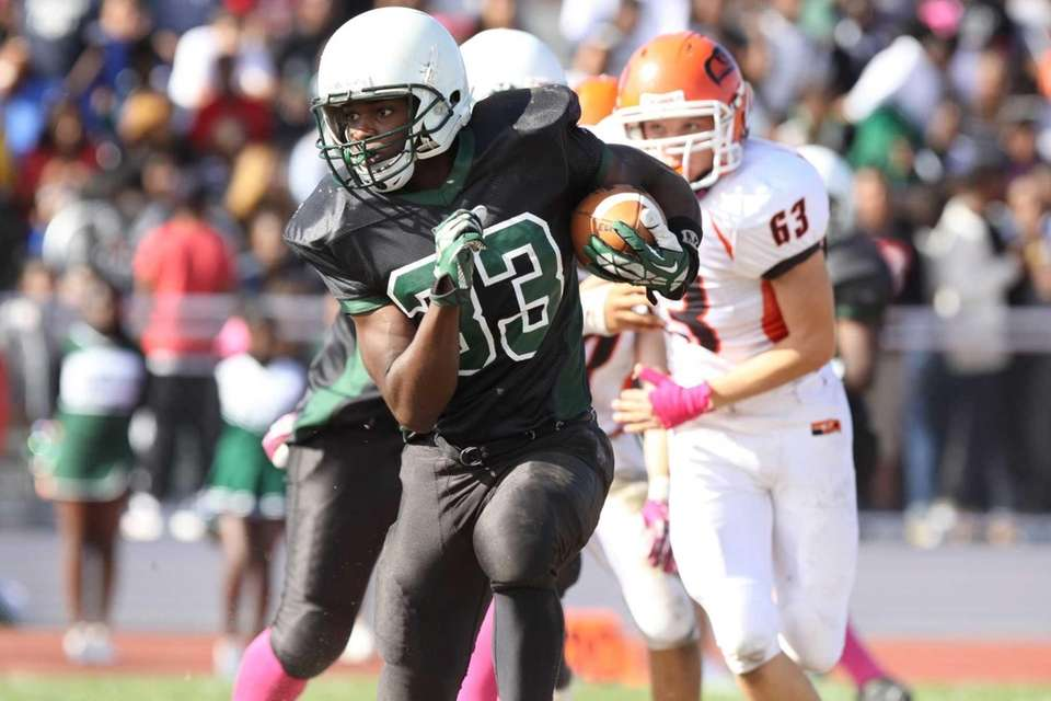 Elmont's Tony White (no. 33) runs the ball