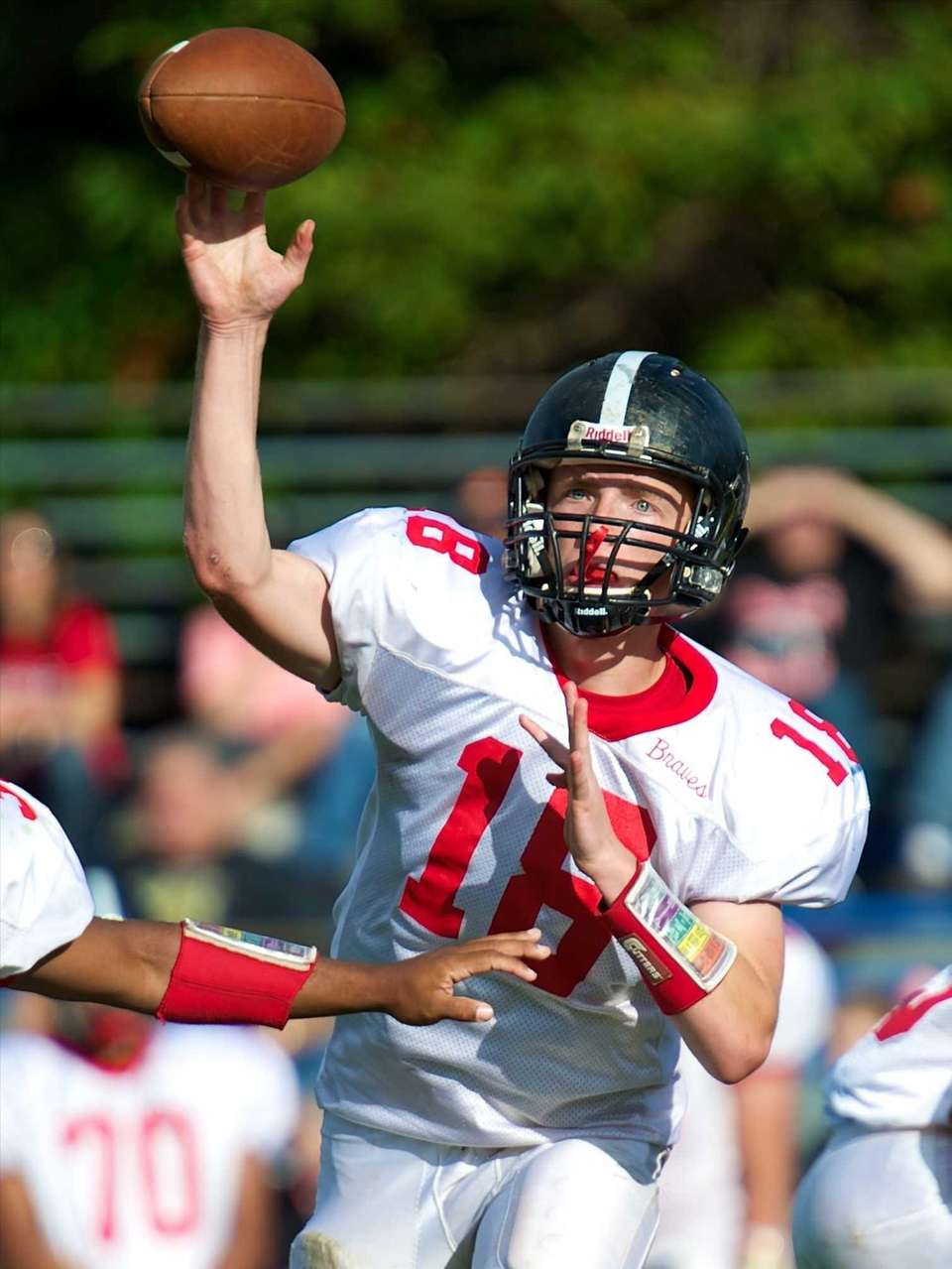 Syosset quarterback Joe Majoy attempts a pass during