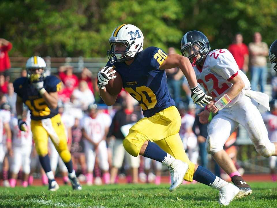 Massapequa running back Nick Capuana (no. 20) breaks