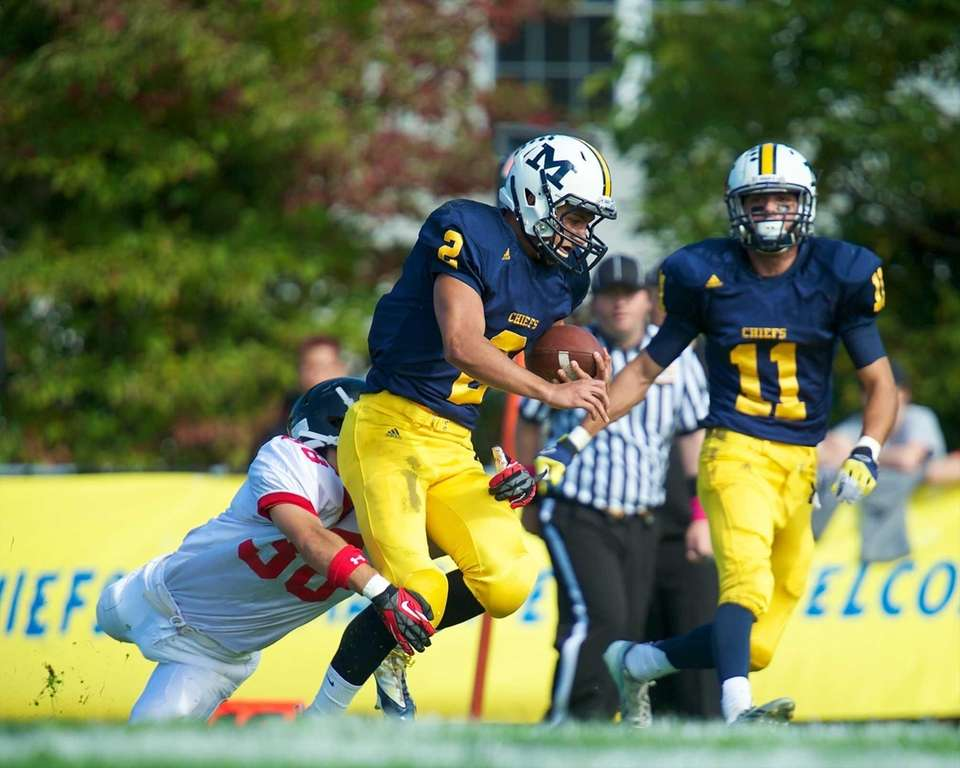 Massapequa quaterback Matthew Caracappa (no. 2) keeps the