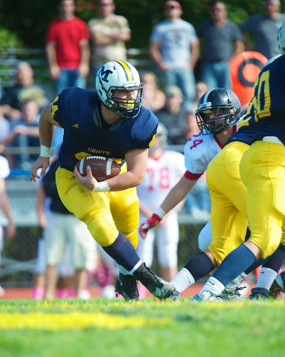 Massapequa running back Paul Dilena (no. 44) rushes