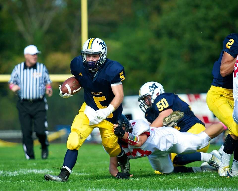 Massapequa running back Jack Korber (no. 5) breaks