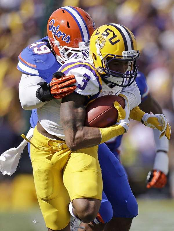LSU wide receiver Odell Beckham (3) carries the