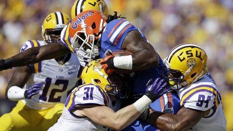 Florida running back Matt Jones is tackled by