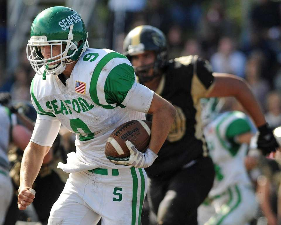 Seaford quarterback Kyle Kolodinsky runs for a short