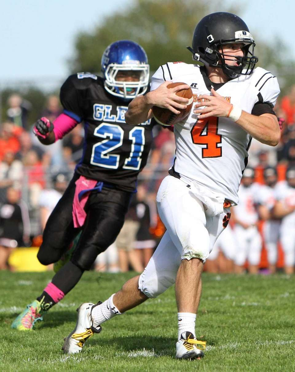 Babylon quarterback Nick Santorelli, right, keeps the ball