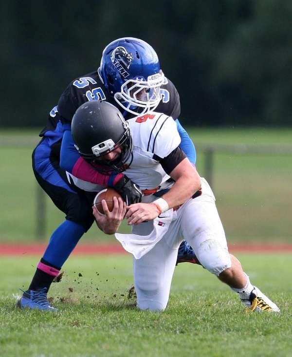 Babylon quarterback Nick Santorell (right) get tackled after