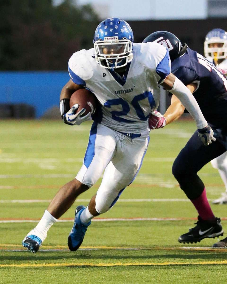Riverhead running back Jeremiah Cheatom (no. 20) runs