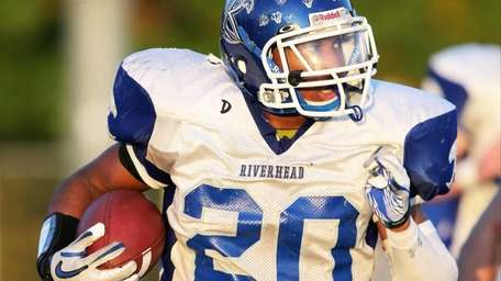Riverhead running back Jeremiah Cheatom rushes for a