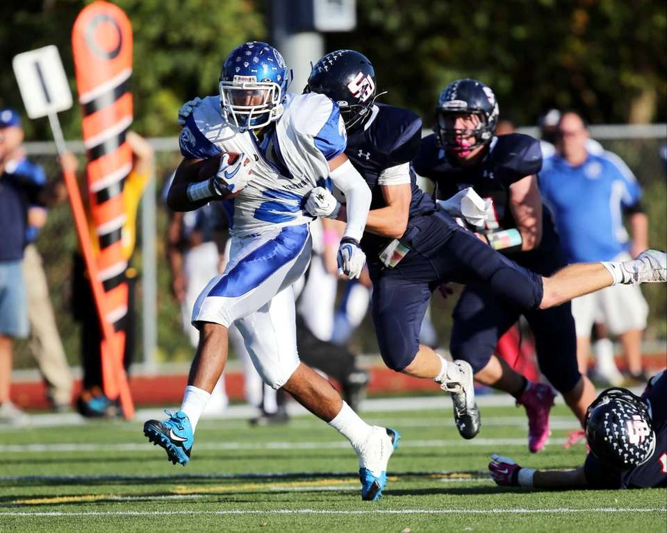 Riverhead running back Jeremiah Cheatom (no. 20) drags