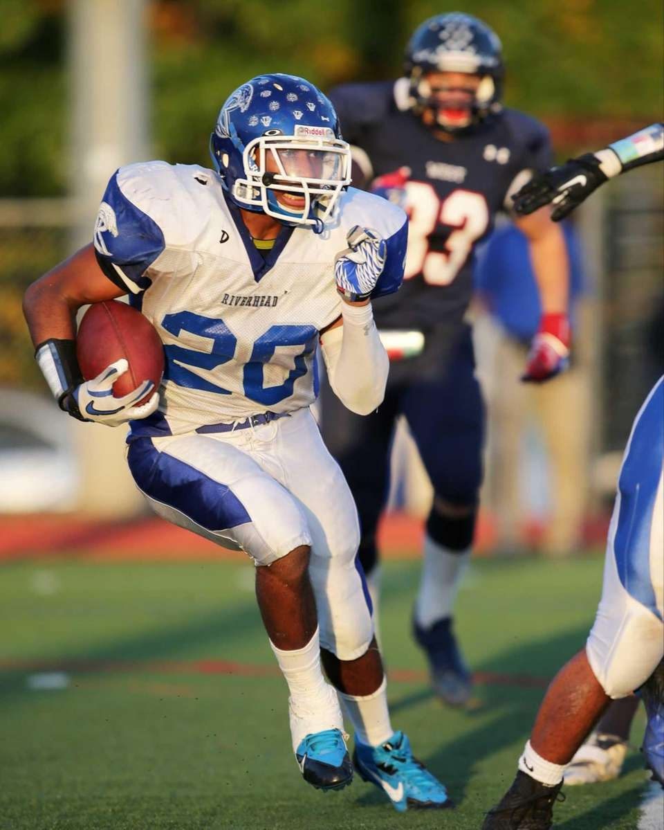 Riverhead running back Jeremiah Cheatom (no. 20) rushes