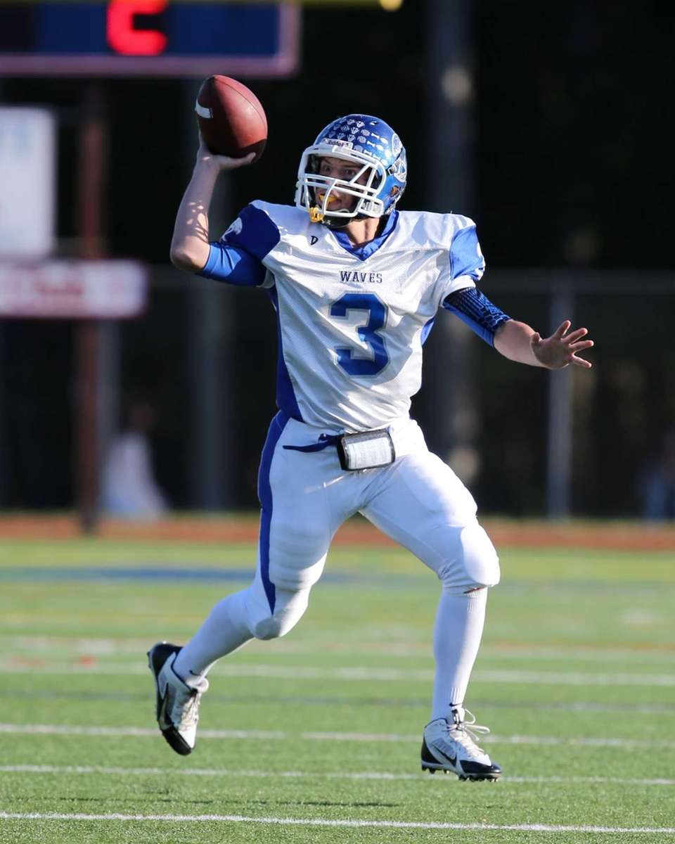 Riverhead quarterback Cody Smith pump fakes as he