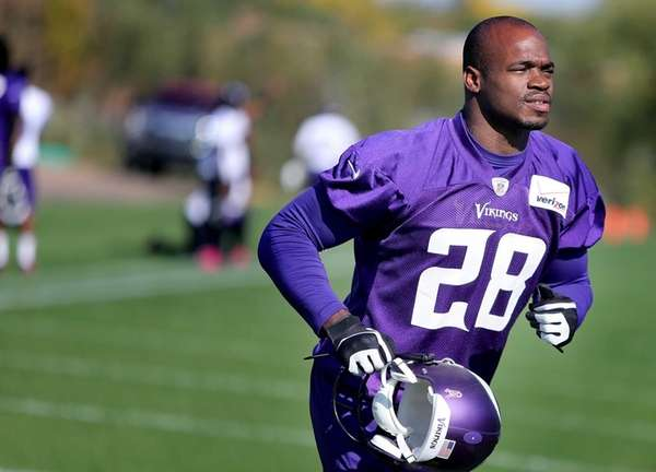 Minnesota Vikings running back Adrian Peterson makes his