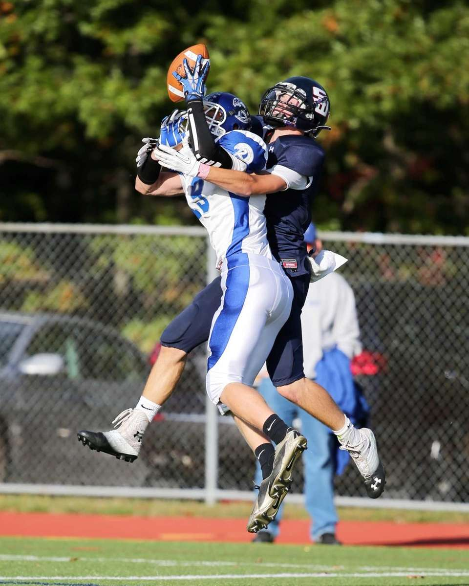 Smithtown West wide receiver Christian Zawadzki (left) knocks