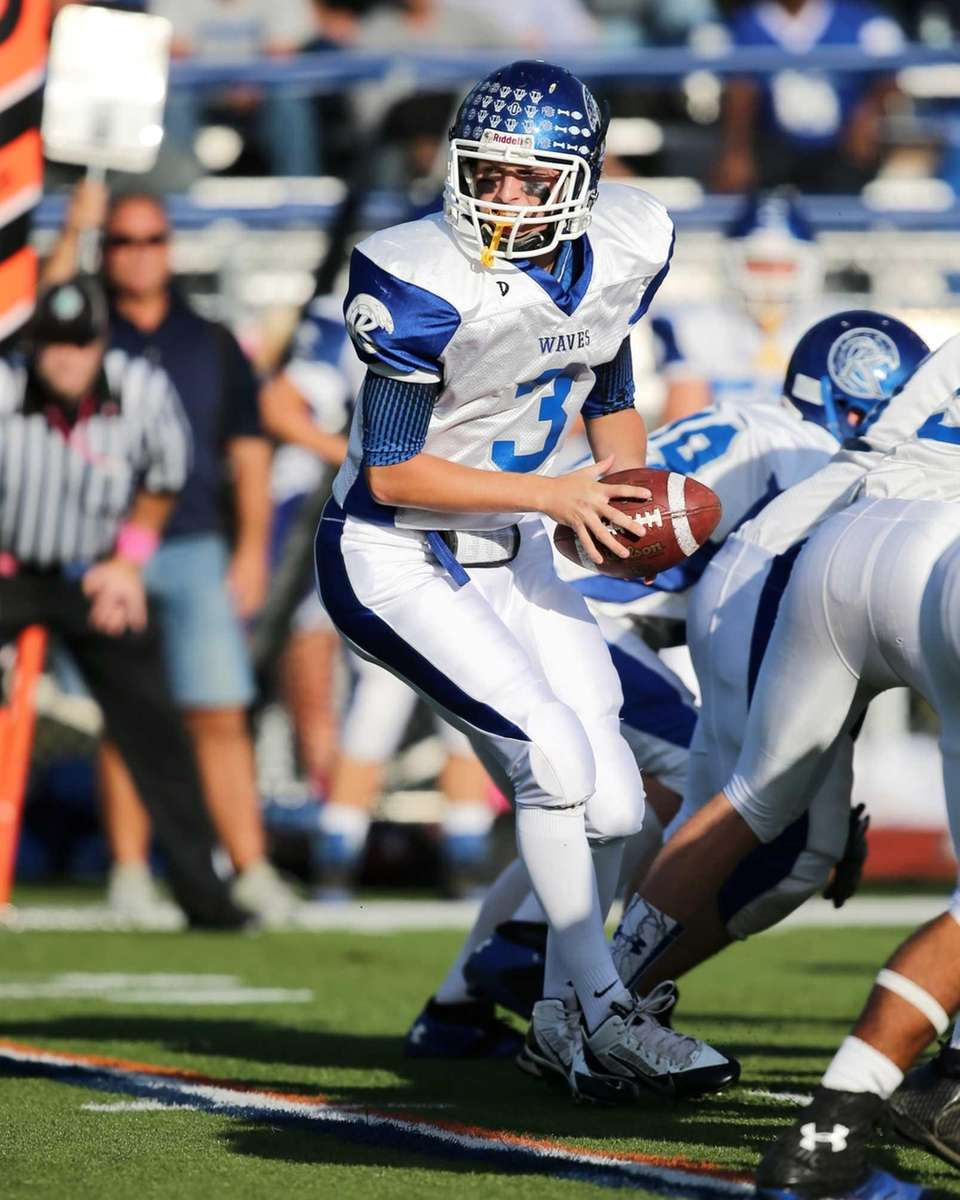 Riverhead Quarterback Cody Smith handles the ball during