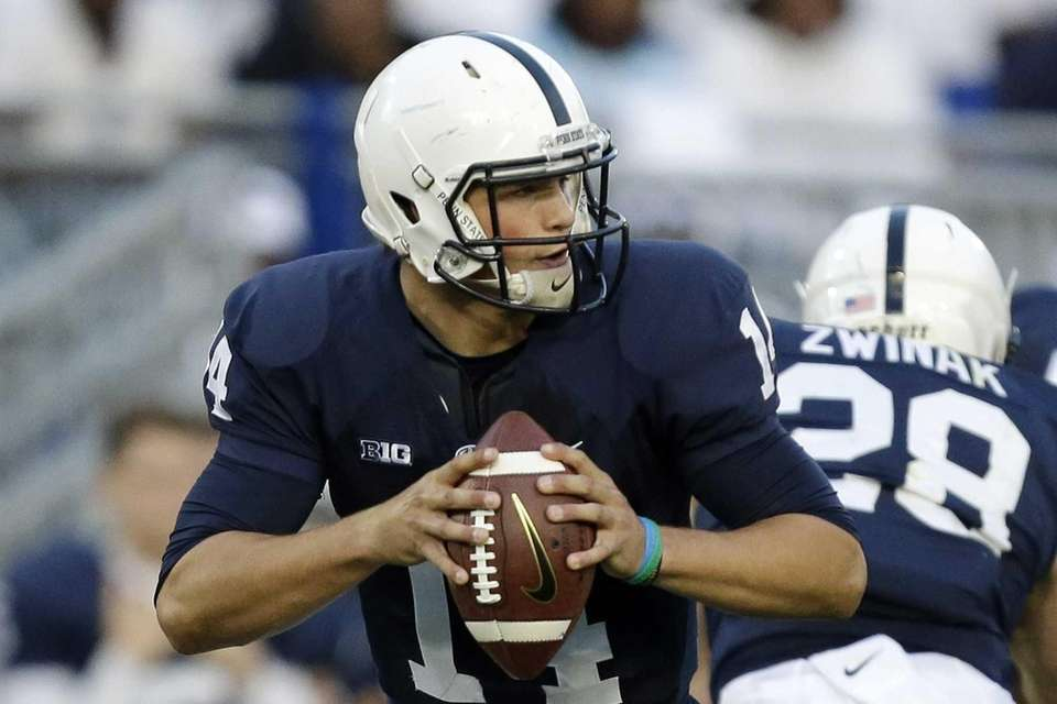 Penn State quarterback Christian Hackenberg (14) looks to