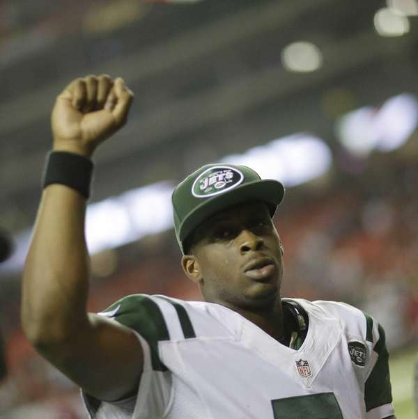 Geno Smith celebrates after the second half of