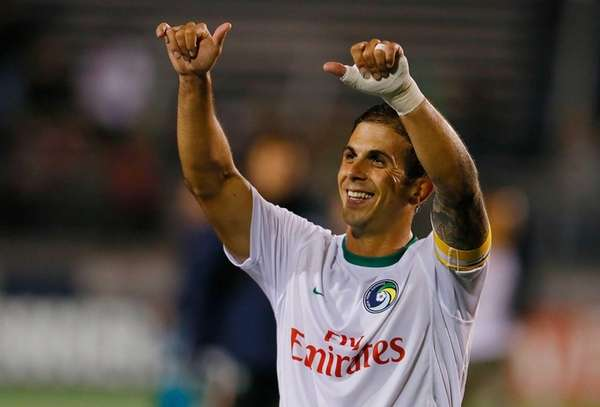 Cosmos defender Carlos Mendes salutes the crowd after
