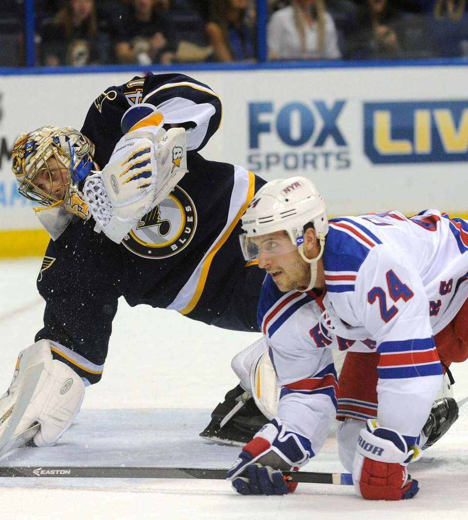 St. Louis Blues goalie Jaroslav Halak (left) defends