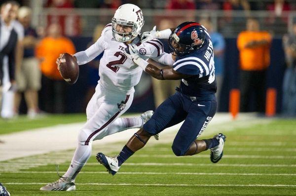 Texas A&M quarterback Johnny Manziel attempts to maneuver