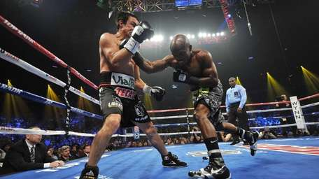 WBO welterweight champion Timothy Bradley Jr., right, throws