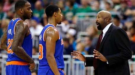 Mike Woodson talks with Toure' Murry (23) and
