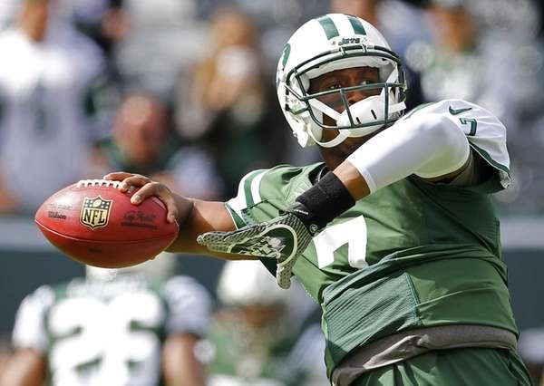 Geno Smith passes during a pregame drill before