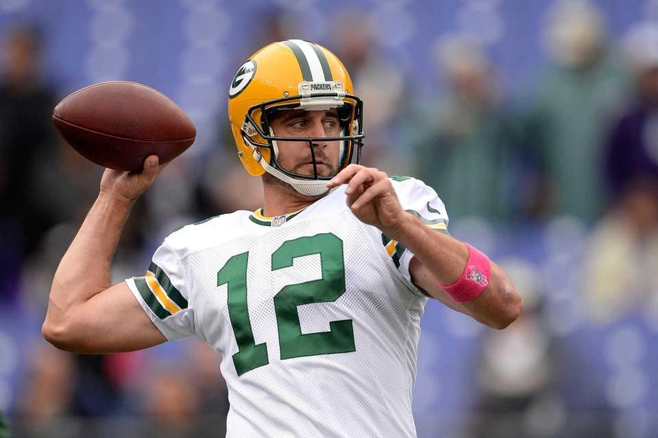 Green Bay Packers quarterback Aaron Rodgers warms up