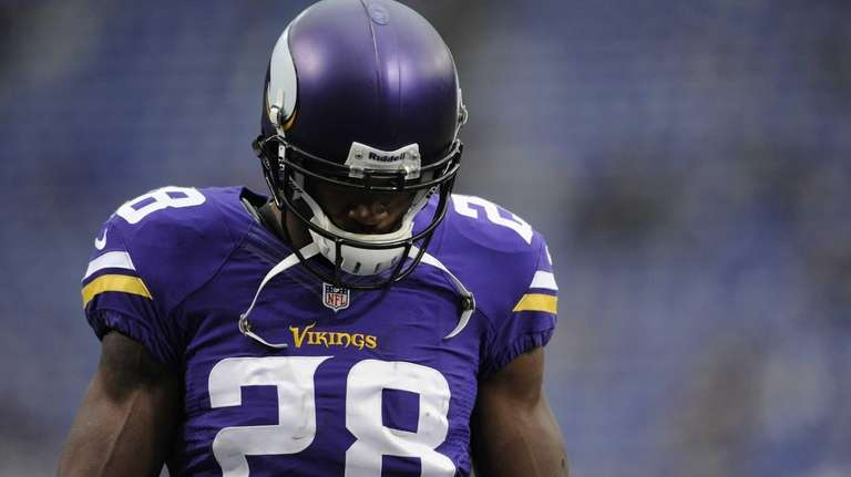 Adrian Peterson looks on before a game against