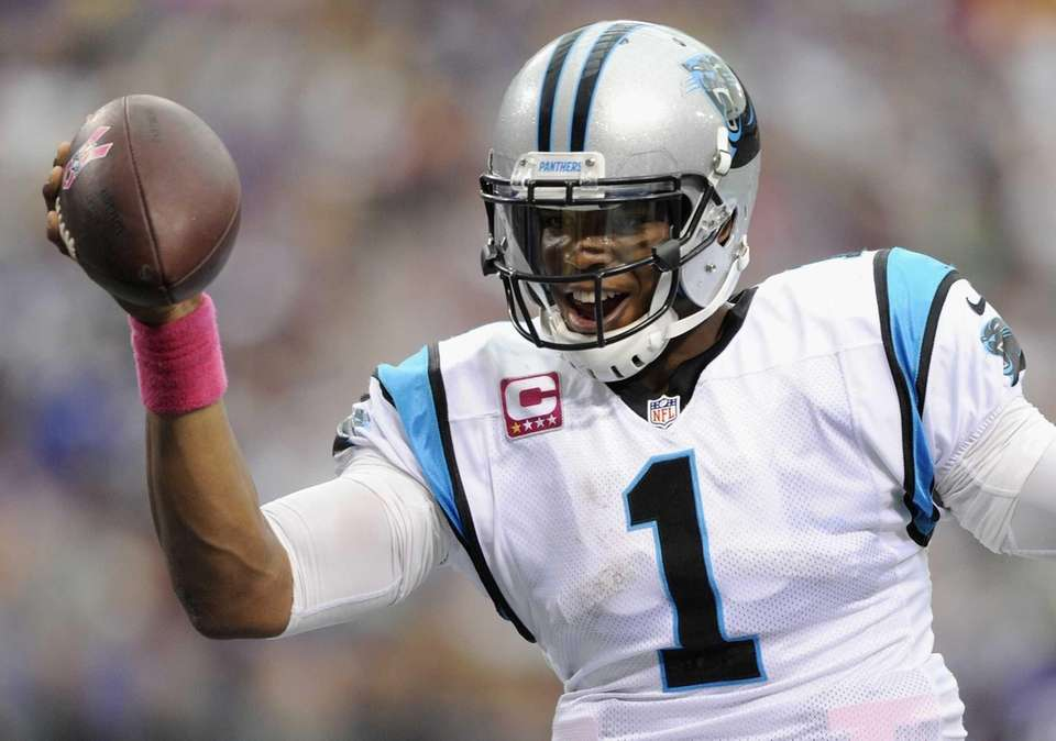 Cam Newton of the Carolina Panthers celebrates scoring