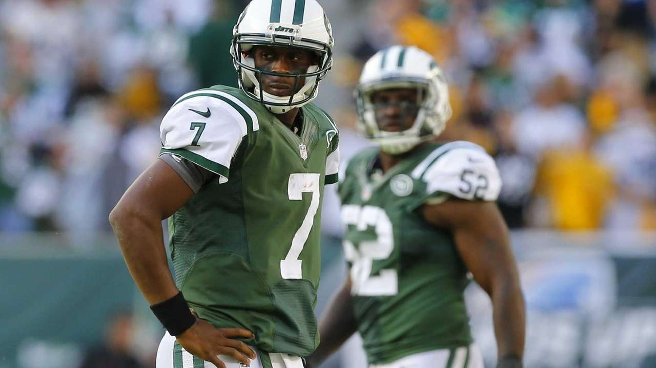 Geno Smith looks on after he threw a