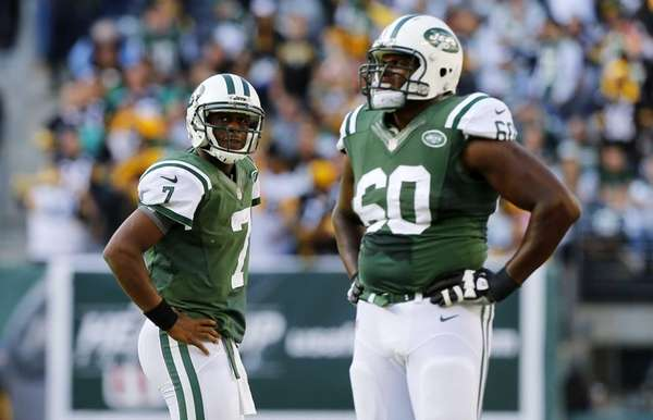 Jets quarterback Geno Smith (left) and offensive tackle