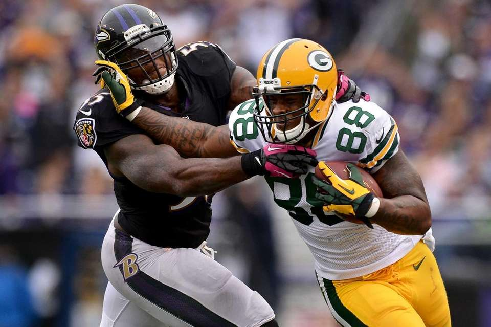 Packers tghtend Jermichael Finley stiff arms Ravens linebacker