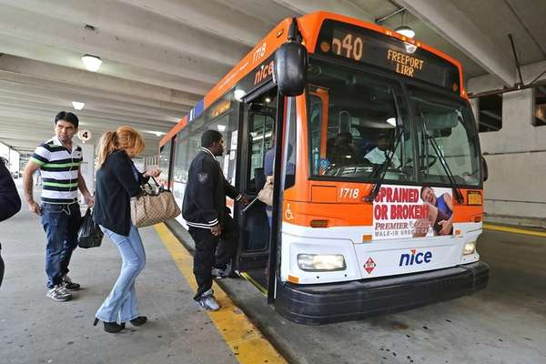 A NICE bus picks up passengers in Mineola
