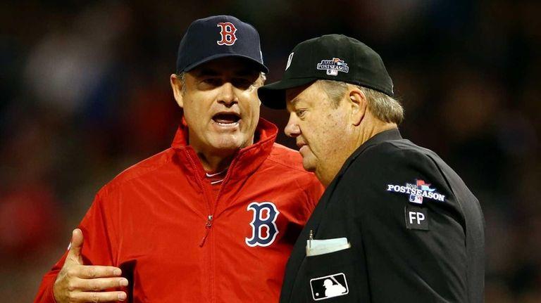 Boston Red Sox manager John Farrell (left) speaks