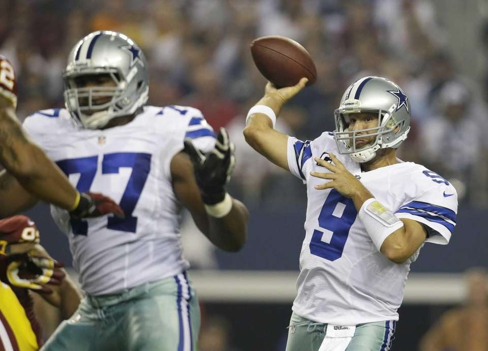 Dallas Cowboys tackle Tyron Smith, left, helps against